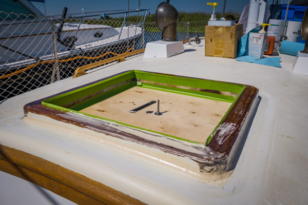 Forward hatch removed and wooden frame epoxied to the cabin top